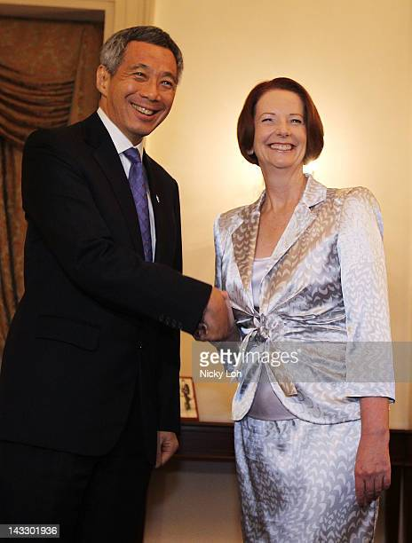 Australian Prime Minister Julia Gillard meets with Singapore Prime Minister Lee Hsien Loong at the Istana on April 23 2012 in Singapore Gillard is...
