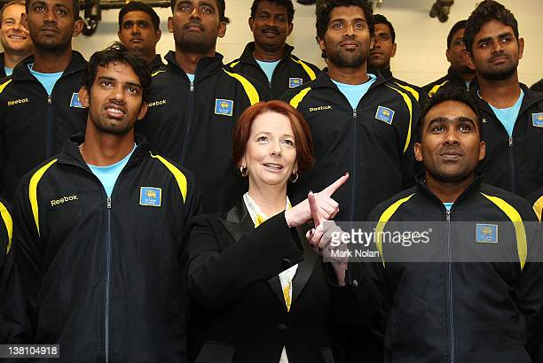 Australian Prime Minister Julia Gillard motions during a team photo with the Sri Lankan cricket team before the International Tour Match between the...