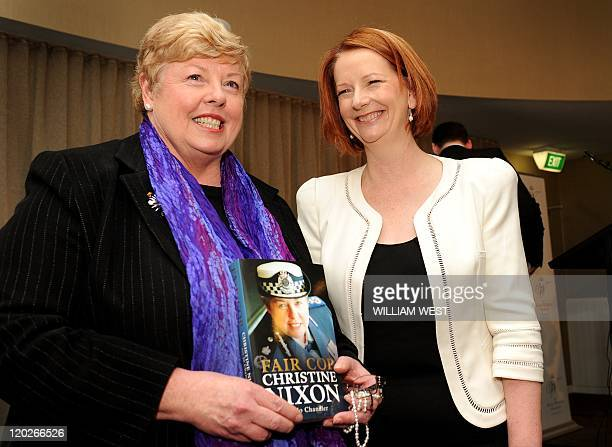 Australian Prime Minister Julia Gillard poses for a photo after launching the book 'Fair Cop' by former Victoria state police commissioner Christine...