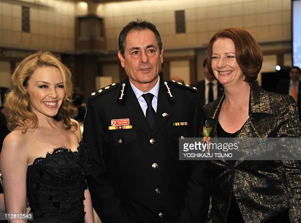 Australian Prime Minister Julia Gillard poses with Australian pop icon Kylie Minogue and Australian relief team chief superintendent Rob McNeil at a...