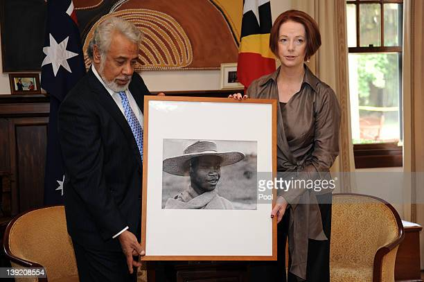 Australian Prime Minister Julia Gillard presents East Timorese Prime Minister Xanana Gusmao with a photographic portrait from the Australian National...