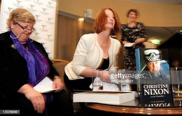 Australian Prime Minister Julia Gillard returns to her seat after launching the book 'Fair Cop' by former Victoria state police commissioner...