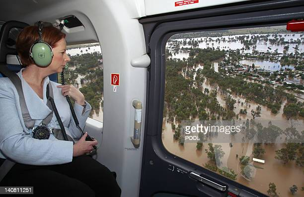 Australian Prime Minister Julia Gillard reviews flood damage from a helicopter above Wagga Wagga on March 7, 2012. Hundreds more people were...