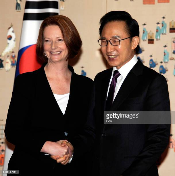Australian Prime Minister Julia Gillard shakes hand with South Korean President Lee MyungBak before their meeting at the presidential house on April...