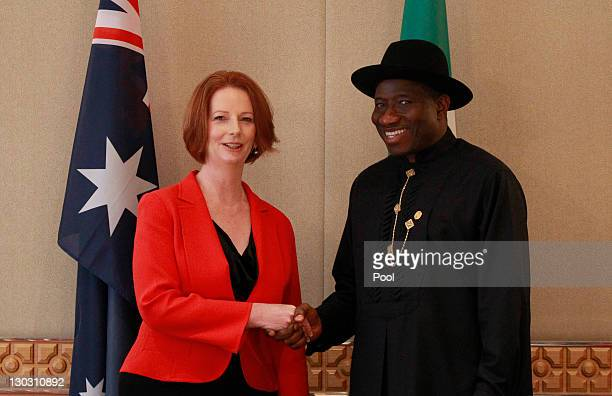 Australian Prime Minister Julia Gillard shakes hands with Nigeria's President Jonathan Goodluck during a bilateral summit ahead of the Commonwealth...