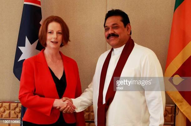 Australian Prime Minister Julia Gillard shakes hands with Sri Lanka President Mahinda Rajapaksa during a bilateral summit ahead of the Commonwealth...