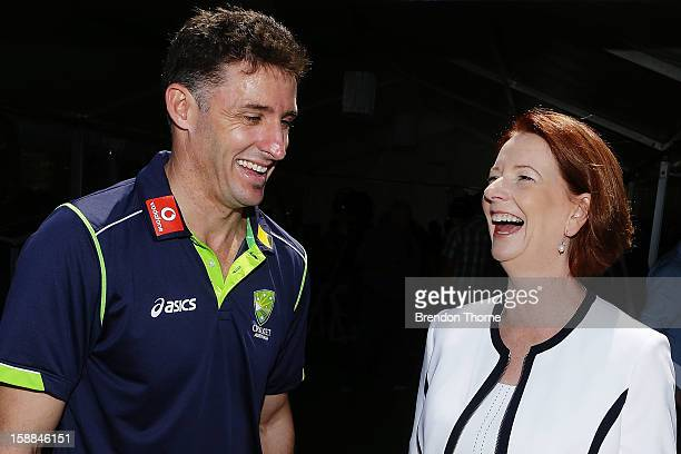 Australian Prime Minister Julia Gillard shares a joke with Michael Hussey of Australia during a function at Kirribilli House on January 1 2013 in...