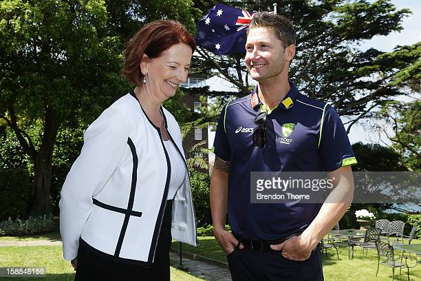 Australian Prime Minister Julia Gillard shares a joke with Michael Clarke of Australia during a function at Kirribilli House on January 1 2013 in...