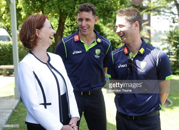 Australian Prime Minister Julia Gillard shares a joke with Michael Hussey and Michael Clarke of Australia during a function at Kirribilli House on...
