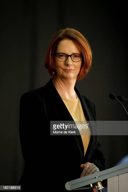 Australian Prime Minister Julia Gillard stands at the lectern inside the community hall at The Hub Recreation Centre on February 20 2013 in Adelaide...