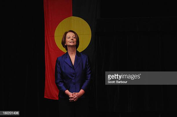 Australian Prime Minister Julia Gillard stands in front of the Aboriginal flag as she launches the Korin Gamadji Institute at the ME Bank Centre on...