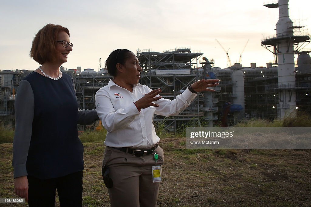 Australian Prime Minister Julia Gillard talks with Corporate Citizenship Advisor Valentina Kaman during a tour of the Exxon-Mobil Liquefied Natural Gas plant on May 10, 2013 in Port Moresby, Papua New Guinea. The three-day visit is a chance for the two nations to strengthen economic ties, with talks being held on key issues including, trade, military defense, and the controversial Australian detention center on Manus Island.The trip is the first official visit for Prime Minister Julia Gillard to the Pacific Island Nation and the first visit since former prime minster Kevin Rudd visited in 2007.
