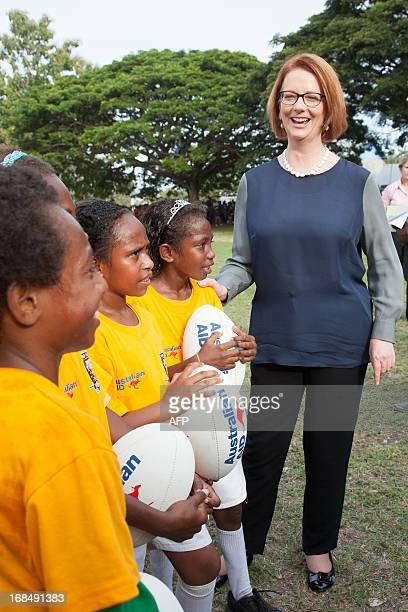Australian Prime Minister Julia Gillard talks with local school children in Port Moresby during her trip to Papua New Guinea on May 10 2013 Gillard...
