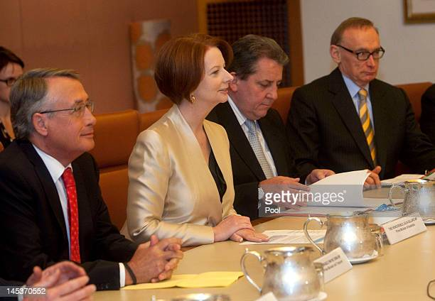 Australian Prime Minister Julia Gillard talks with Prime Minister of Thailand Ms Yingluck Shanawatra during a cabinet meeting at Parliament House on...