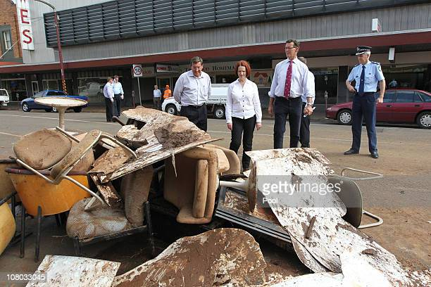 Australian Prime Minister Julia Gillard Toowoomba's Mayor Peter Taylor and MP Terry Shine look at the debris on January 14 2010 in Toowoomba...