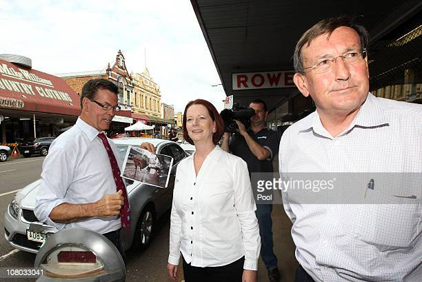 Australian Prime Minister Julia Gillard visits Toowoomba guided by Toowoomba's Mayor Peter Taylor and MP Terry Shine on January 14 2010 in Toowoomba...