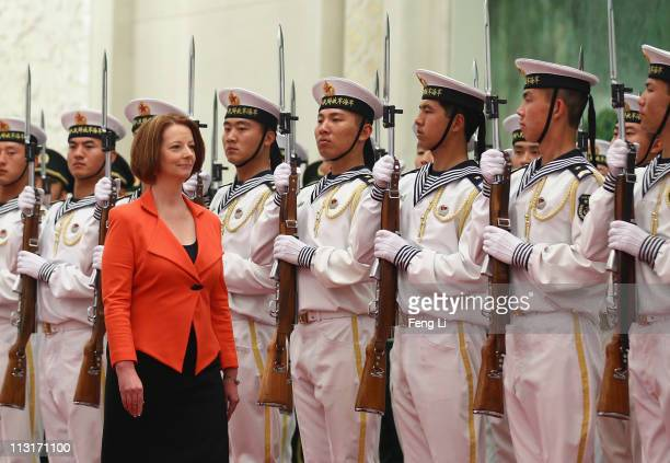 Australian Prime Minister Julia Gillard walks past a honour guard during a welcoming ceremony inside the Great Hall of the People on April 26, 2011...