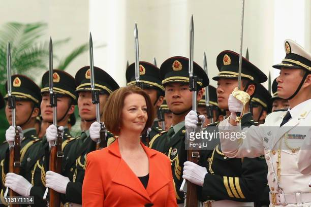 Australian Prime Minister Julia Gillard walks past a honour guard during a welcoming ceremony inside the Great Hall of the People on April 26 2011 in...