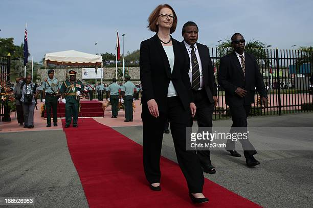 Australian Prime Minister Julia Gillard walks to her waiting plane ahead of her departure from Jackson International Airport on May 11 2013 in Port...