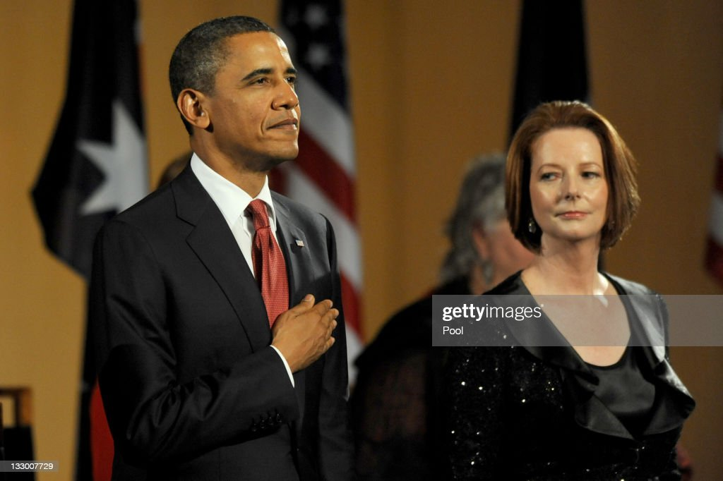 Australian Prime Minister Julia Gillard watches US President Barack Obama during the playing of the national anthems before a parliamentary dinner on the first day of his 2-day visit to Australia, on November 16, 2011 in Canberra, Australia. The President will today receive a Cermeonial Welcome, attend a bi-lateral meeting and hold a joint media conference with Julia Gillard, and attend a Parliamentary Dinner this evening, before addressing Parliament and heading to Darwin tomorrow.