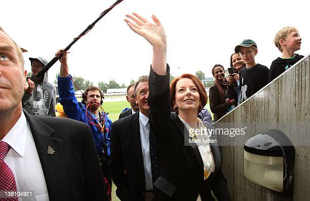 Australian Prime Minister Julia Gillard waves to fans before the International Tour Match between the Prime Minister's XI and Sri Lanka at Manuka...