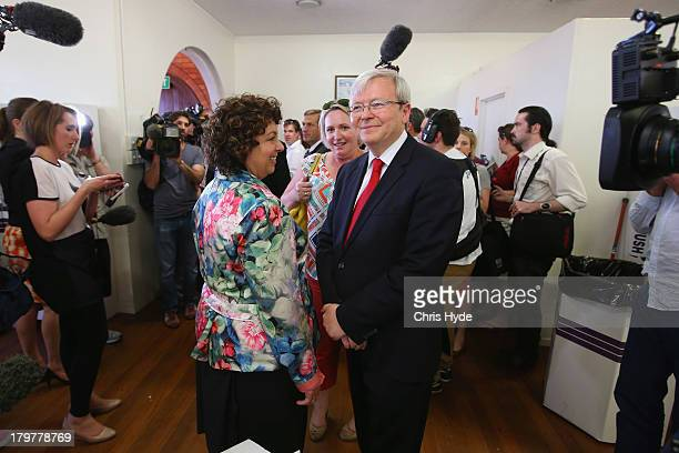 Australian Prime Minister Kevin Rudd and his wife Therese Rein wait for media to leave after voting at St Paul's Church in the seat of Griffith on...