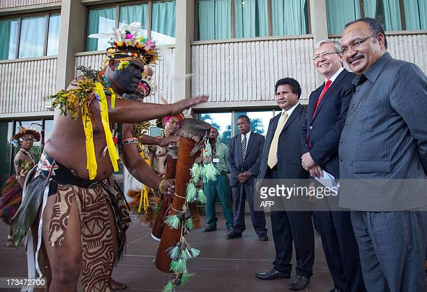 Australian Prime Minister Kevin Rudd and Papua New Guinea's Prime Minister Peter O'Neill watch traditional dancers in Port Moresby on July 15 2013...