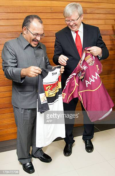 Australian Prime Minister Kevin Rudd and Papua New Guinea's Prime Minister Peter O'Neill exchange a Queensland Maroons and a Kumuls jumper in Port...