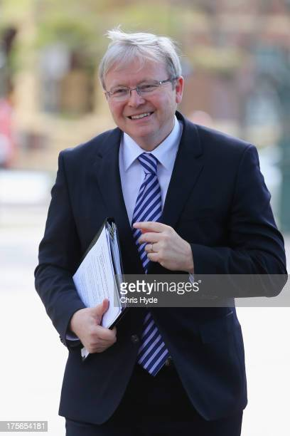 Australian Prime Minister Kevin Rudd arrives for a media conference at the Botanic Gardens on August 6 2013 in Brisbane Australia Rudd joined Deputy...