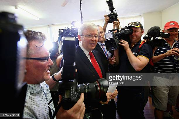 Australian Prime Minister Kevin Rudd arrives to vote at St Paul's Church in the seat of Griffith on September 7 2013 in Brisbane Australia After a...