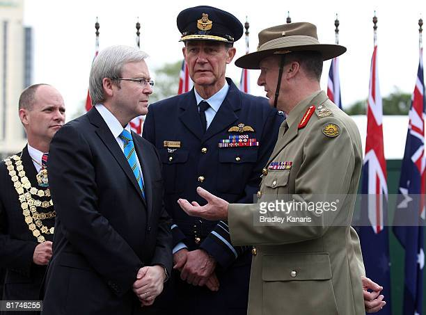Australian Prime Minister Kevin Rudd Chief of Defence Angus Houston and Major Peter Leahy chat immediately after Australian soldiers who served in...