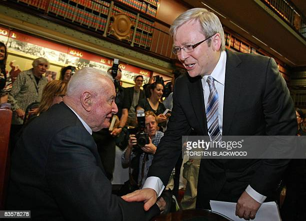 Australian Prime Minister Kevin Rudd congratulates former prime minister Gough Whitlam during the launch of his biography at Parliament House in...