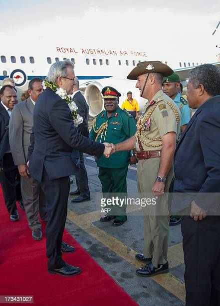 Australian Prime Minister Kevin Rudd greets Australian Defence Staff Colonel Dick Parker after arriving in Port Moresby on July 14 2013 Rudd is...