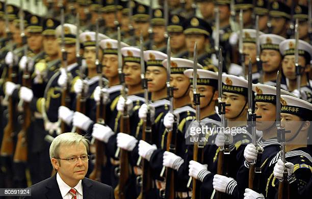 Australian Prime Minister Kevin Rudd inspects the guardofhonour during a welcoming ceremony at the Great Hall of the People in Beijing on April 10...