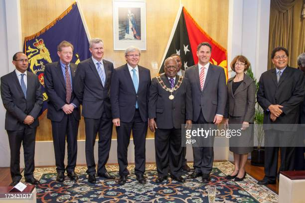 Australian Prime Minister Kevin Rudd Kevin poses with PNG Governor General Michael Ogio and other officials at Government House after arriving in...