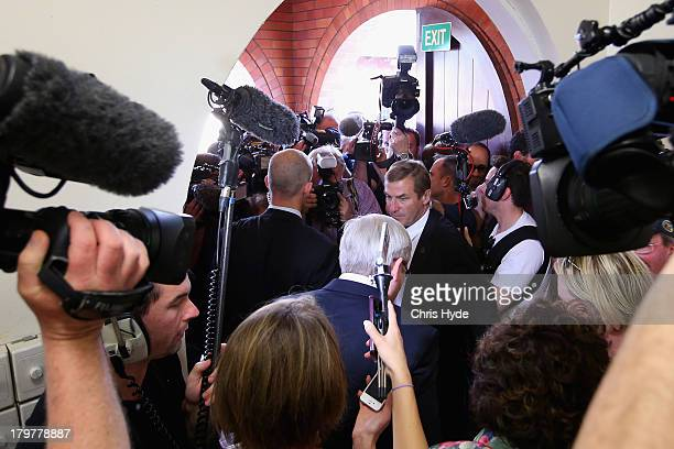 Australian Prime Minister Kevin Rudd leaves after voting at St Paul's Church in the seat of Griffith on September 7 2013 in Brisbane Australia After...