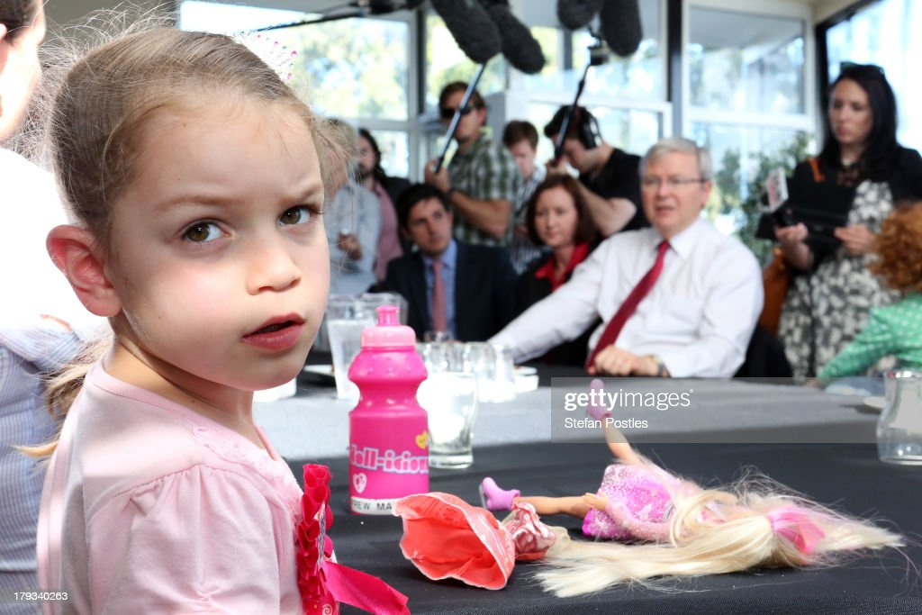 Australian Prime Minister, Kevin Rudd looks on as a young girl appears disinterested at Bramble Bay Bowls Club on September 2, 2013 in Woody Point, Australia. According to the News Limited Newspoll, the Coalition is up 8 points on Labor on a two-party preferred basis, with Tony Abbott surpassing Kevin Rudd in the poll as preferred Prime Minister 43 to 41 per cent. Australian voters will head to the polls on September 7 to elect the 44th parliament.