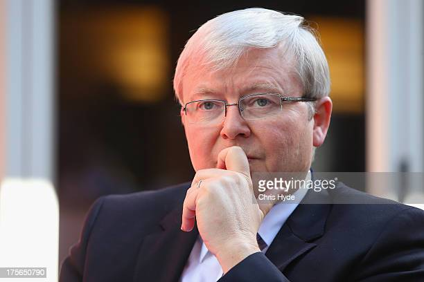Australian Prime Minister Kevin Rudd looks on during a debate at the Colmslie Hotel on August 6, 2013 in Brisbane, Australia. On the second day of...