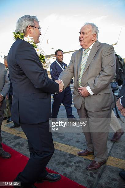 Australian Prime Minister Kevin Rudd meets Kevin Dacey Australian Trade Commissioner to Papua New Guinea after arriving in Port Moresby on July 14...