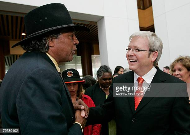 Australian Prime Minister Kevin Rudd meets with television personality Ernie Dingo after delivering an apology to the Aboriginal people for...