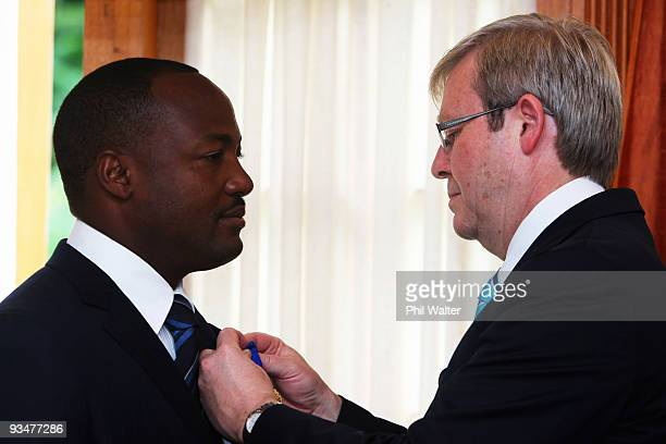 Australian Prime Minister Kevin Rudd presents former West Indies cricketer Brian Lara with the insignia of the Order of Australia during a ceremony...