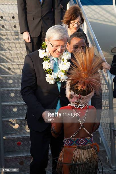 Australian Prime Minister Kevin Rudd receives a lei after arriving in Port Moresby on July 14 2013 Rudd is touring Papua New Guinea on a twoday visit...