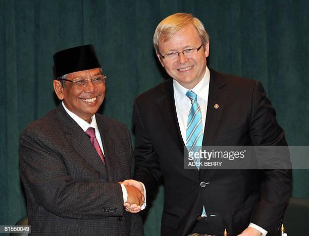 Australian Prime Minister Kevin Rudd shakes hand with Indonesian Hasyim Muzadi, the leader of Nahdlatul Ulama in Jakarta on June 13, 2008. Rudd...