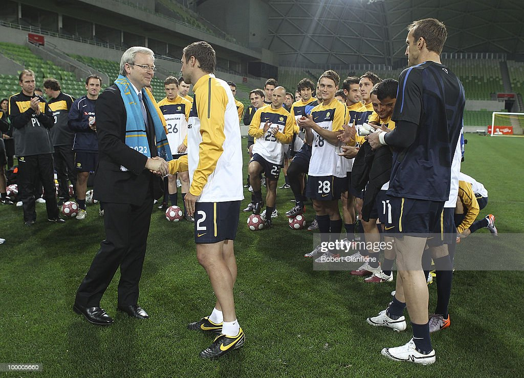 Australian Prime Minister Kevin Rudd shakes hands with Australian captain Lucas Neill and prior to an Australian Socceroos training session at AAMI Park on May 20, 2010 in Melbourne, Australia.