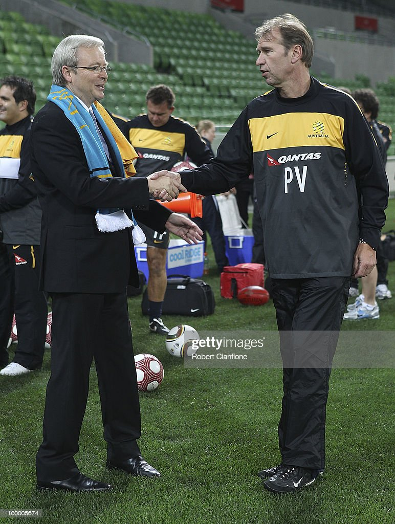 Australian Prime Minister Kevin Rudd shakes hands with Australian coach Pim Berbeek and prior to an Australian Socceroos training session at AAMI Park on May 20, 2010 in Melbourne, Australia.