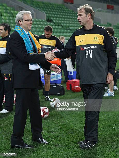 Australian Prime Minister Kevin Rudd shakes hands with Australian coach Pim Berbeek and prior to an Australian Socceroos training session at AAMI...