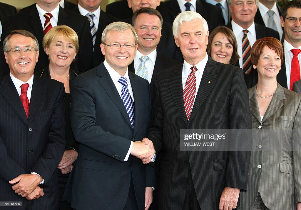 Australian Prime Minister Kevin Rudd (3th L) shakes hands with Governor-General Michael Jeffery (3rd R) at Government House in Canberra, 03 December 2007, after he was sworn in as Australia's 26th prime minister following a landslide election win nine days ago against long-serving conservative leader John Howard. Rudd took the oath of office before Governor-General Michael Jeffery at Government House in Canberra, launching a new era in which the centre-left leader has pledged to roll back many of Howard's policies. AFP PHOTO/William WEST