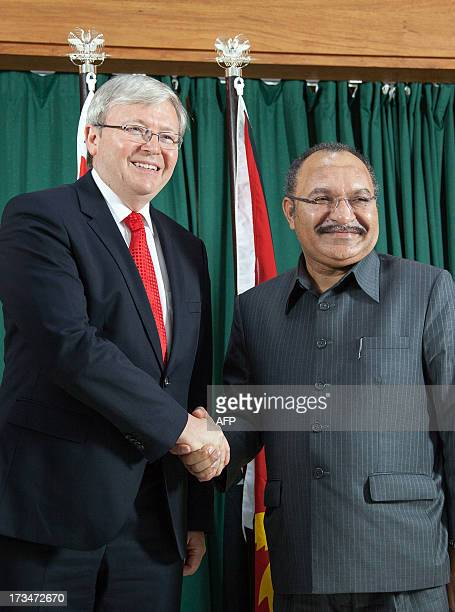 Australian Prime Minister Kevin Rudd shakes hands with Papua New Guinea's Prime Minister Peter O'Neill in Port Moresby on July 15 2013 Australia on...