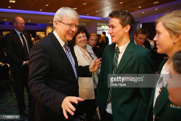 Australian Prime Minister Kevin Rudd talks to school children after a debate at the Colmslie Hotel on August 6, 2013 in Brisbane, Australia. On the...