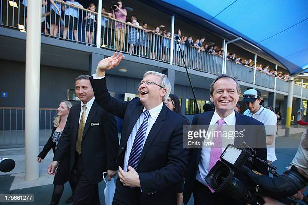 Australian Prime Minister Kevin Rudd waves to children during a visit to Brisbane Adventist College with Local member Laura Fraser Hardy and Minister...